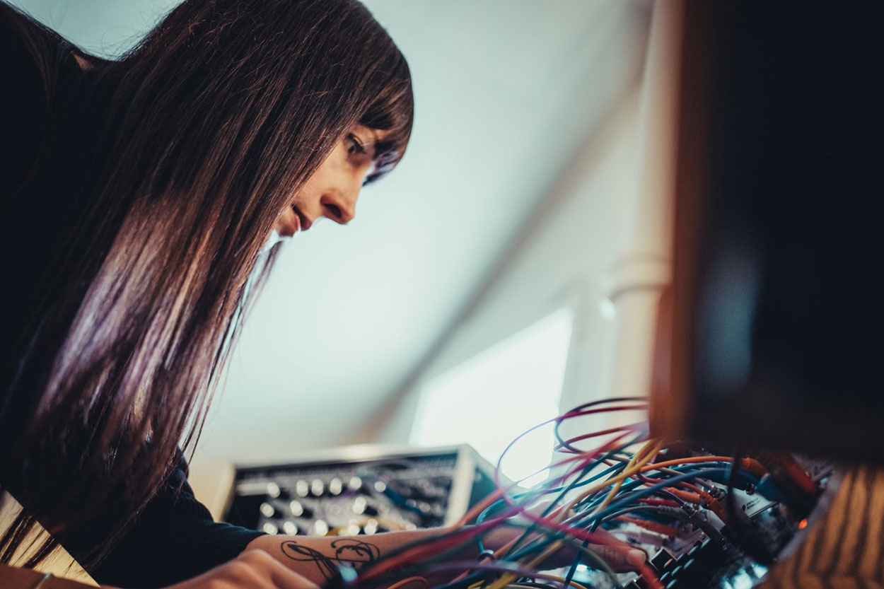 Michelle surrounded by synths.